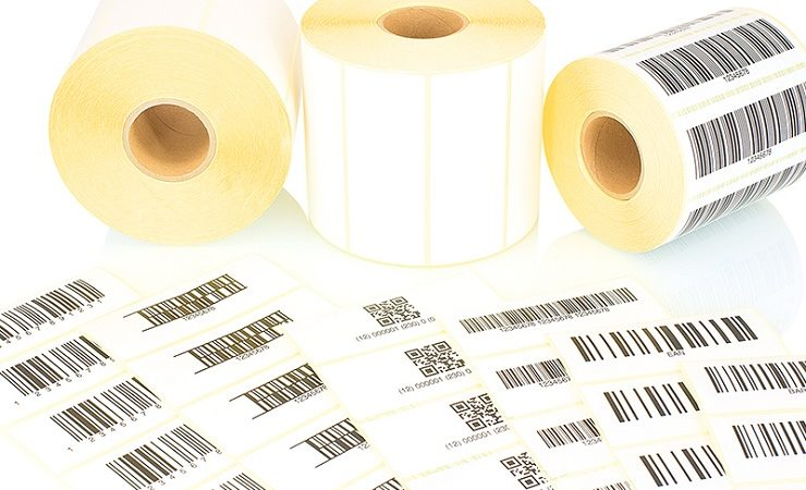 White label rolls and printed barcodes isolated on white backgro